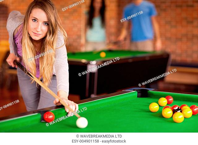 Cute woman playing snooker