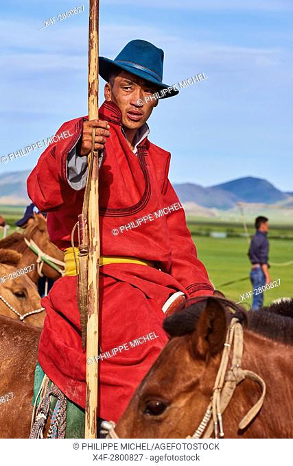 Mongolia, Bayankhongor province, Naadam, traditional festival, portrait of a young man in deel, traditional costume