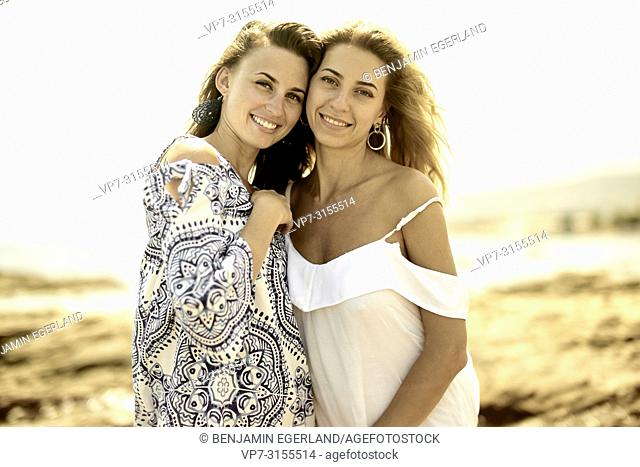 Two women at beach, Crete, Greece