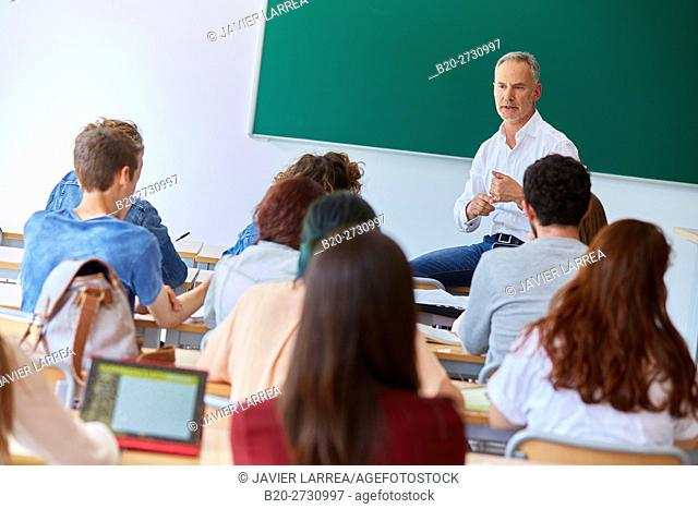 Professor with students at business school