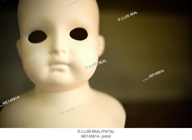 Head and bust eyeless porcelain doll. ,