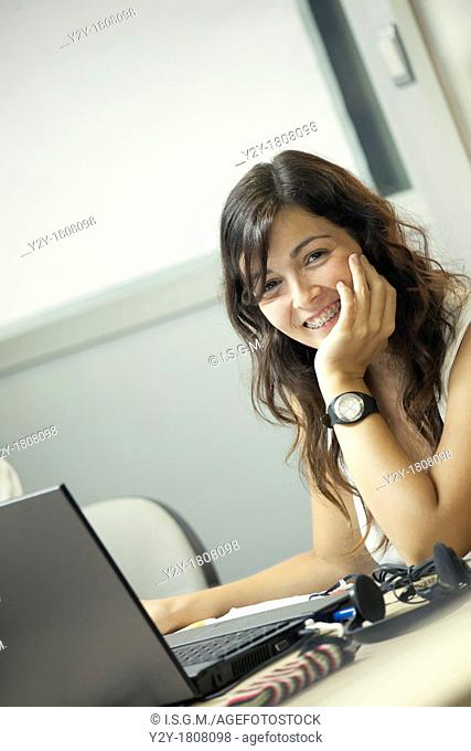 Young woman with dental braces at work