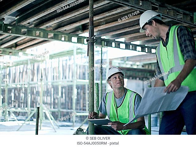 Construction workers using tablet computer