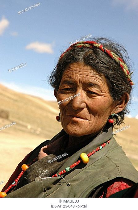 View of an old woman looking away