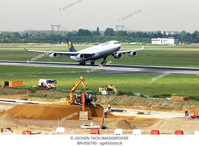 Renovating runway M-Mike, 3000 metre long main taxiway, 20 months, in 11 sections for more than 40 million euros, Lufthansa airbus A340 one of 3 planes...