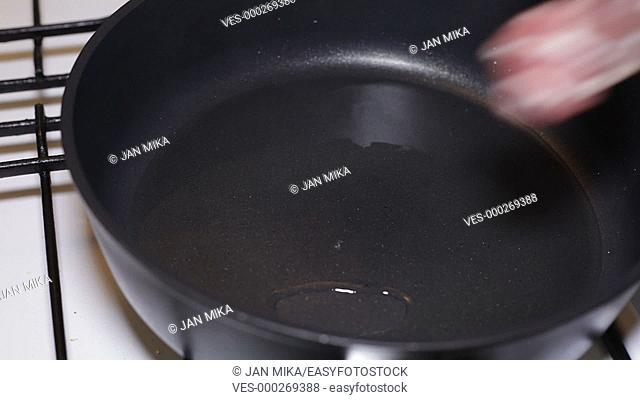 Closeup of frying pork meat on pan