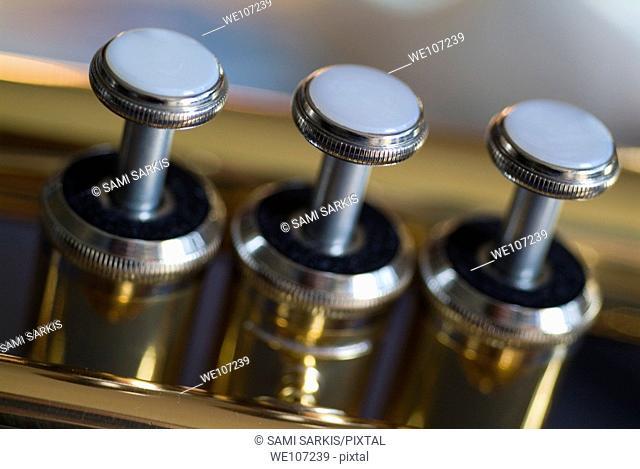 Three musical keys on a shiny trumpet
