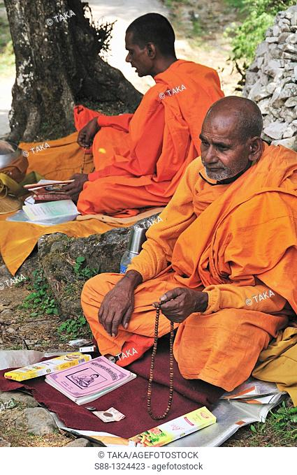 Indian Buddhist monks praying by the quiet pass. McLeod Ganj, Dharamsala, India