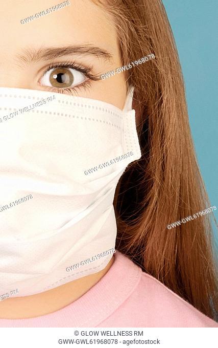 Portrait of a girl wearing a flu mask