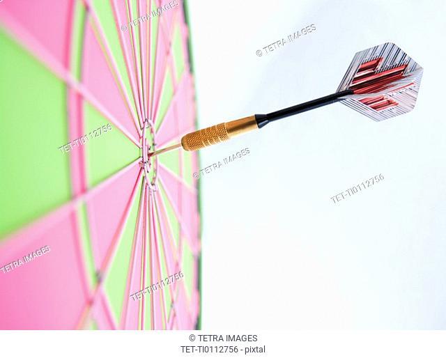 Profile of dart stuck in bulls eye