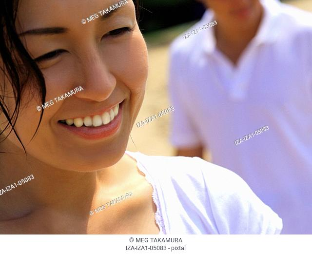 Close-up of a young woman smiling