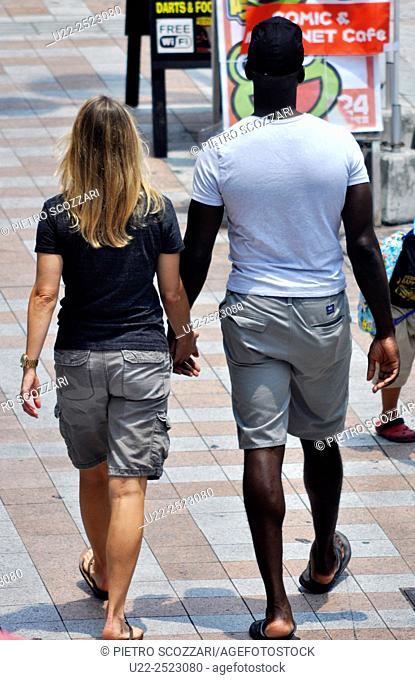 Naha, Okinawa, Japan: mixed couple, American soldiers walking along Kokusai-dori