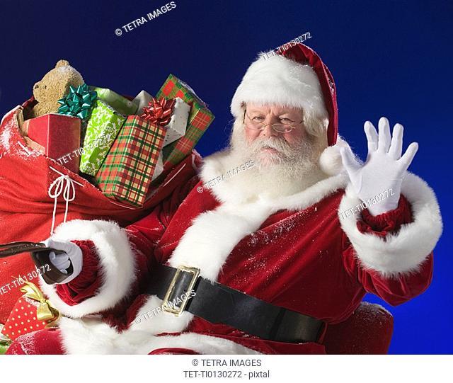 Santa Claus next to bag of toys