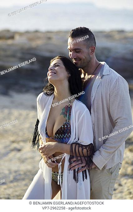 happy couple enjoying togetherness at beach. Greek ethnicity. In holiday destination Hersonissos, Crete, Greece