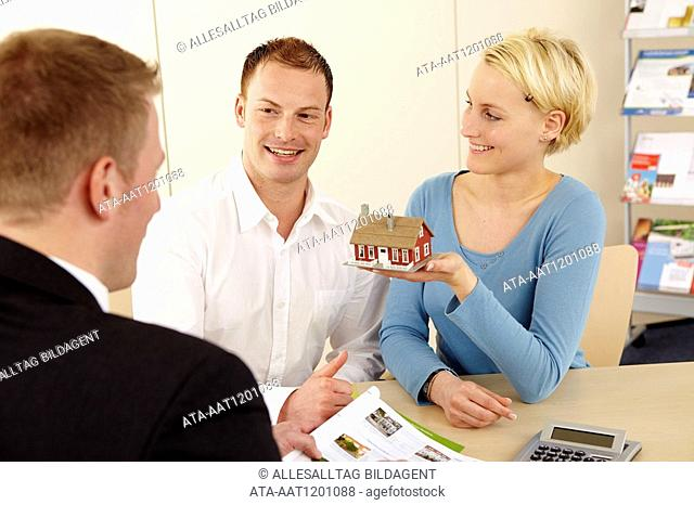 Young couple acquiring a property