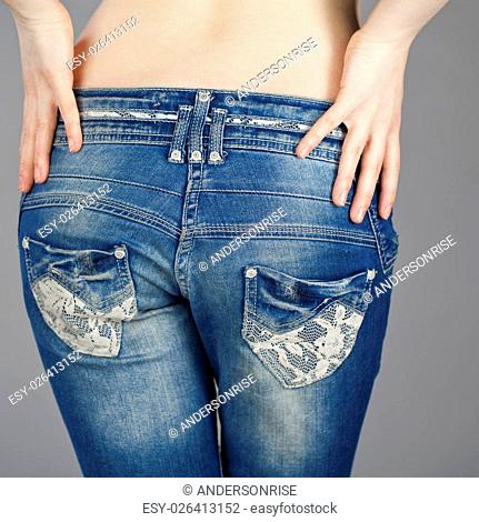 Rear view, female denim pants, isolated on gray background