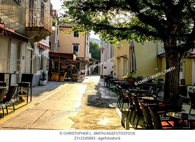 Tables and chairs of Tapas Bars in Baska on the island of Krk Croatia early morning