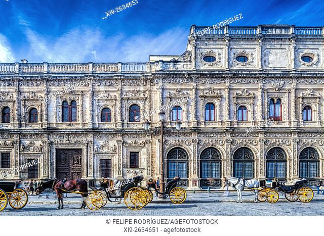 Carriages in front of the plateresque style facade of Seville City Hall (16th Century), Spain