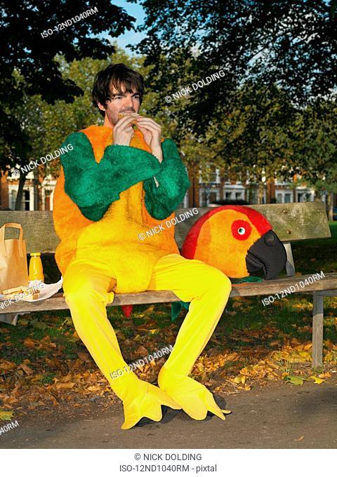 Man dressed in parrot suit
