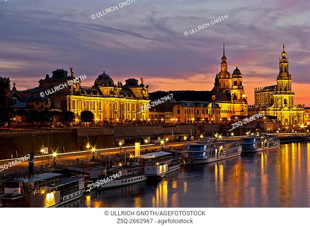 View of the historical waterfront of the Old Town of the city of Dresden, Saxony, Germany, at sunset with the Blue Hour setting in