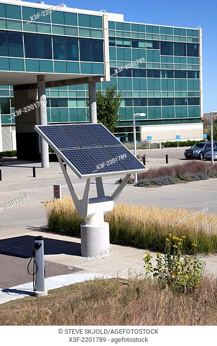 Solar panel helps power charging stations for fuel-efficient cars. Great River Energy headquarters. Maple Grove Minnesota MN USA