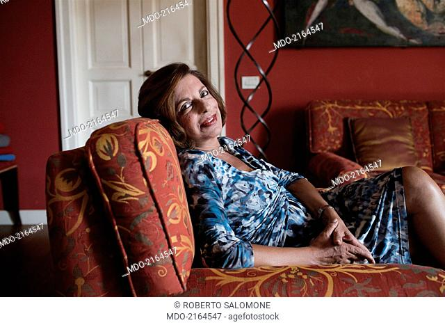 Portrait of the judge district attorney of Palermo Teresa Maria Principato sitting comfortably on the sofa. She runs the pool working for seizing the mafia boss...
