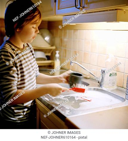 A boy washing up the dishes, Sweden