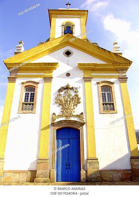 belo horizonte mg blue door with yellow and white church facade
