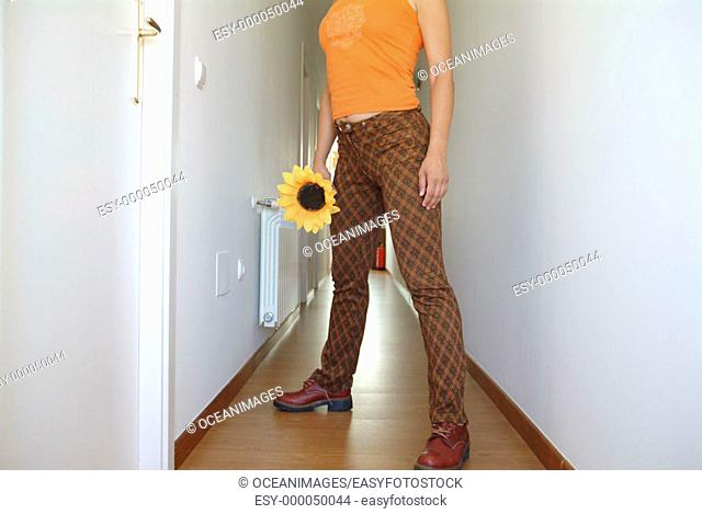 Woman with flower in corridor