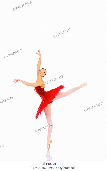 Professional ballet dancer posing at studio. Isolated over white background