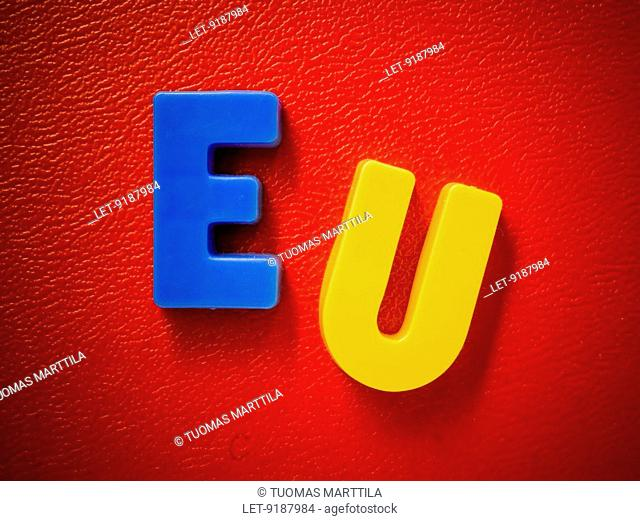 European Union. Word EU written with colourful magnet characters. Blue, yellow, red