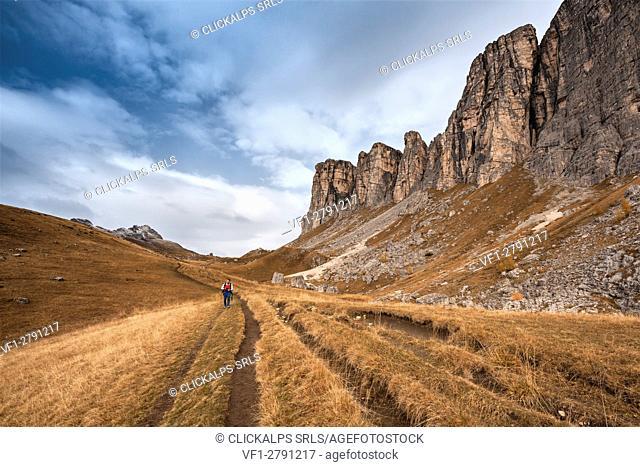 Europe, Italy, Veneto, Belluno. Hiker in the foothills of Lastoni di Formin, Mondeval, Dolomites