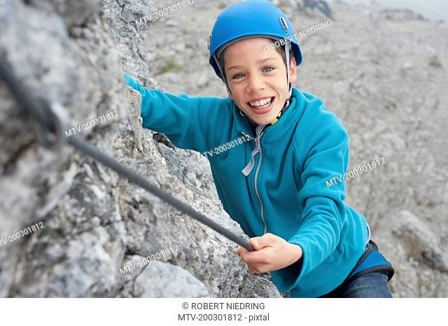 Young teenage boy helmet rope climbing safety