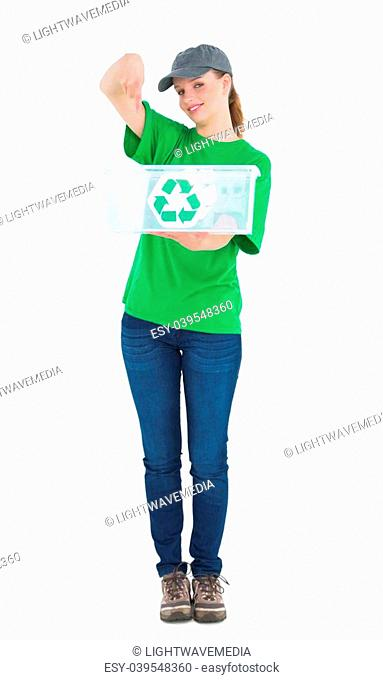 Happy pretty environmental activist showing a recycling box on white background