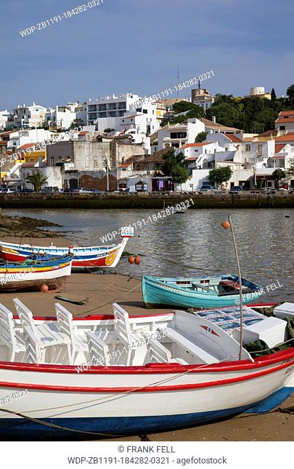 Portugal, Algarve, Ferragudo, View of Village & Boats on the Beach