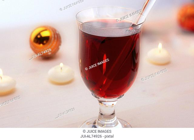 Detail view of a drink with a glass stirrer