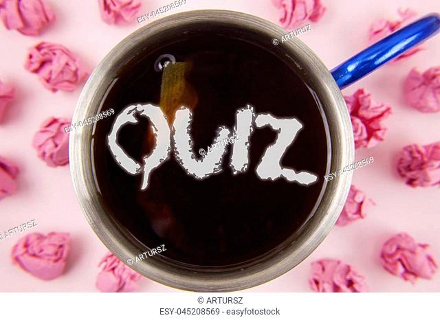 Conceptual hand writing showing Quiz. Business photo showcasing Short Tests Evaluation Examination to quantify your knowledge written Tea in Cup within Paper...