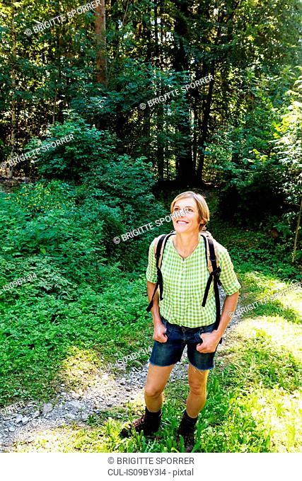 Woman exploring forest, Sonthofen, Bayern, Germany
