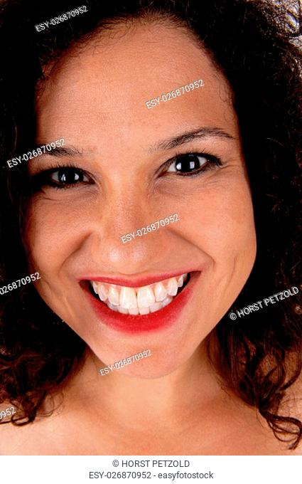 A beautiful young woman in a closeup portrait with curly brunette hair, .isolated for white background.