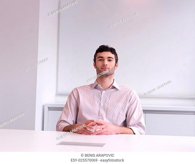 happy young business man portrait at modern meeting office indoors