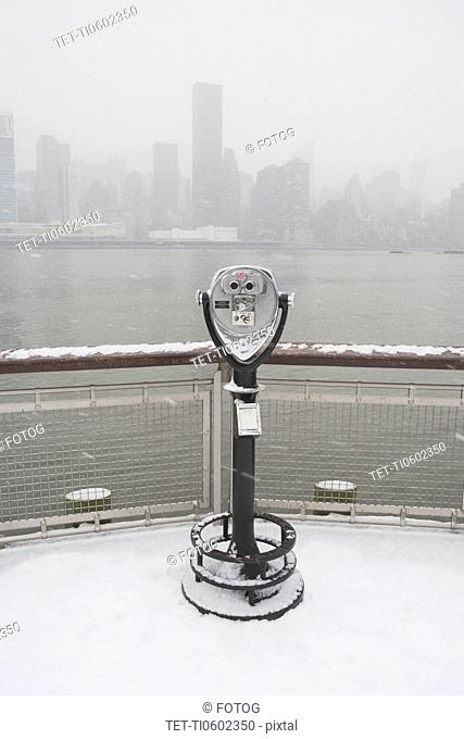 USA, New York City, coin operated binoculars overlooking foggy Manhattan
