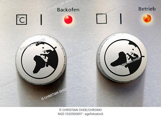 Adjusting knob of an oven with globe, global warming