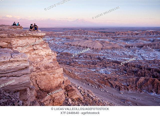 Tourist in Piedra del Coyote (Coyote Rock). Panorama on Valle de la Luna (Valley of the Moon ), and salt deposited on the ground, near San Pedro de Atacama