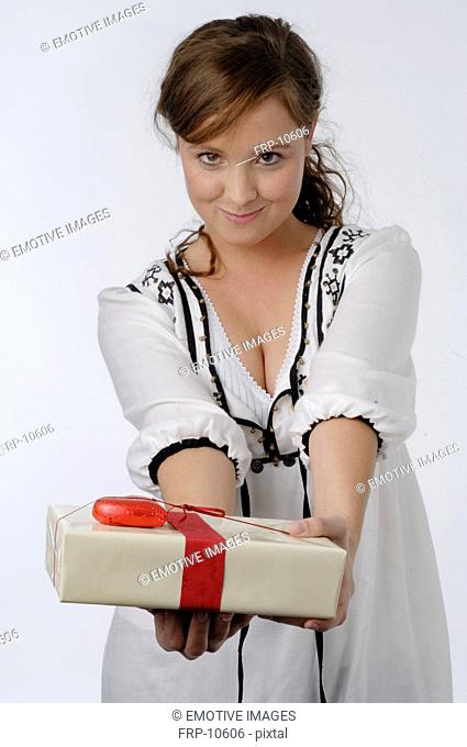 Young woman holding gift box