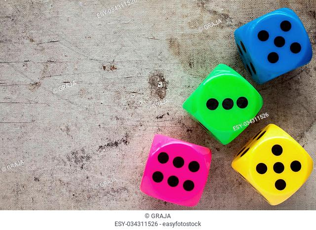 Dices on canvas background with copy-space. Top view
