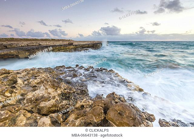 Waves of the rough sea crashing on the cliffs of Devil's Bridge Caribbean Antigua and Barbuda Leeward Islands West Indies