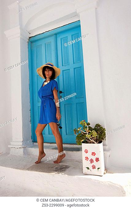 Woman in front of a Cyclades house, Amorgos, Cyclades Islands, Greek Islands, Greece, Europe