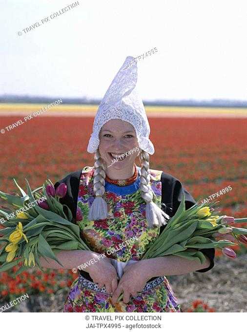 Bulb Fields / Tulip Fields / Girl Dressed in Dutch Costume with Tulips, Lisse, Holland (Netherlands)