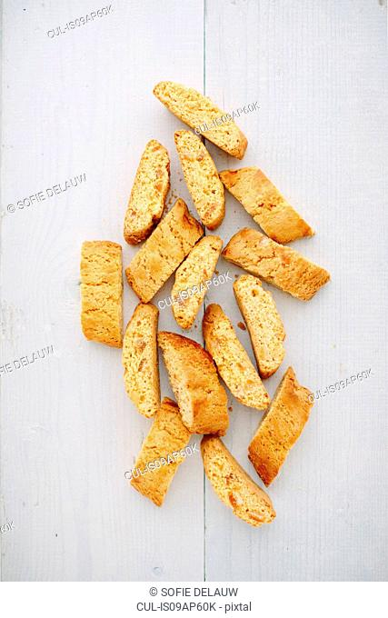 Overhead view of almond cantucci biscuits on tablecloth