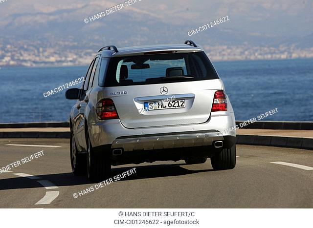 Car, Mercedes ML 500, model year 2005-, silver, cross country vehicle, driving, diagonal from the back, rear view, country road